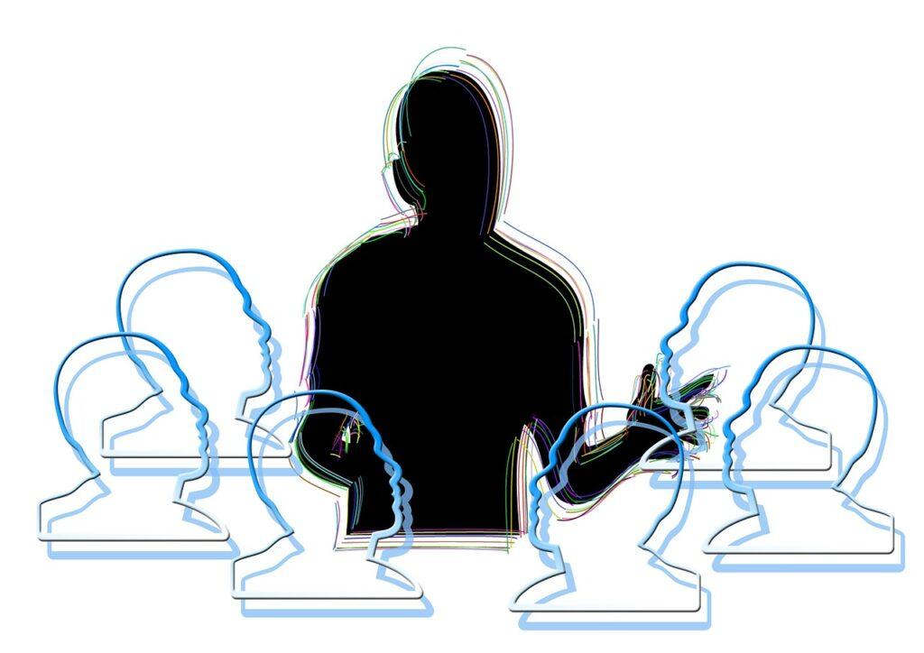 An illustration describing a teacher mentoring teenagers