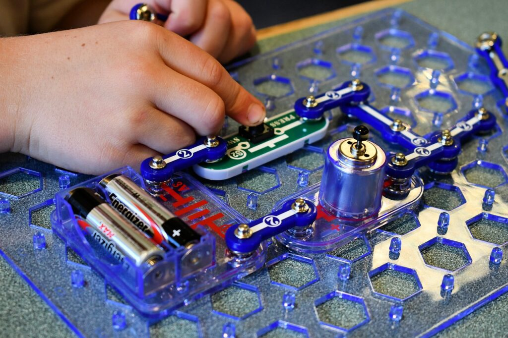 child experimenting with a circuit to depict the importance of STEM education